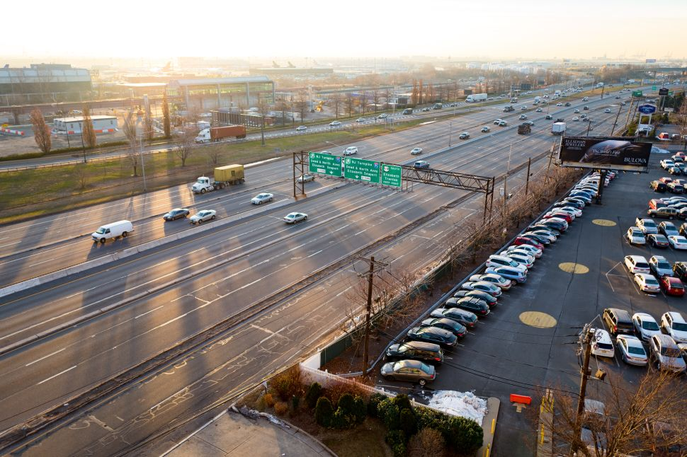 At dawn, cars drive down the US 9 highway past Newark Liberty International Airport, Newark, New Jersey.