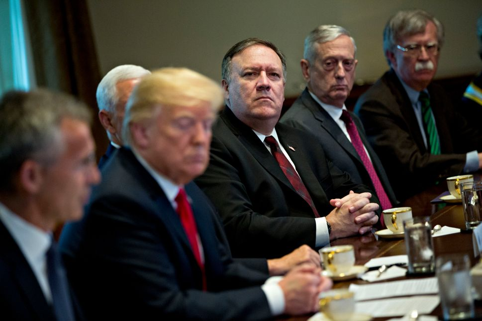 John Bolton, Jim Mattis and Mike Pompeo listen to President Donald Trump.
