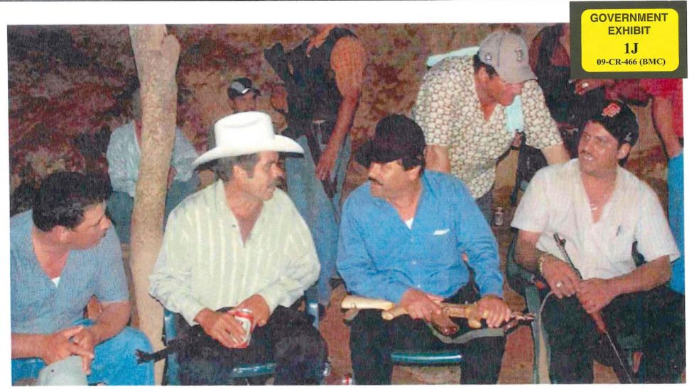 El Chapo (center in the black hat) is pictured in government evidence holding a golden AK-47.