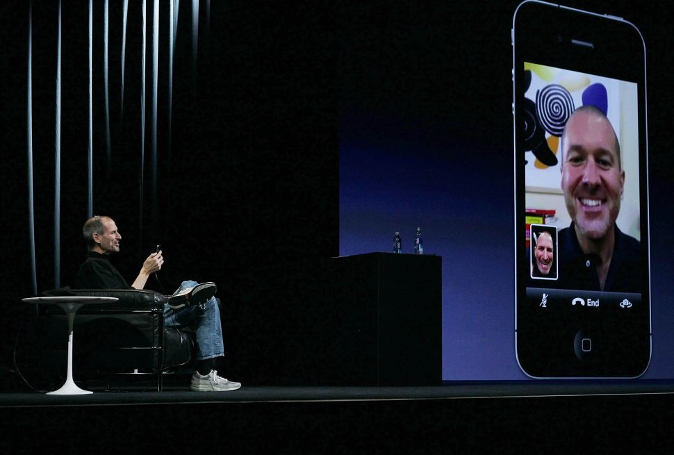 Former Apple CEO Steve Jobs demonstrates FaceTime video conferencing on an iPhone 4 at the 2010 Apple World Wide Developers conference.