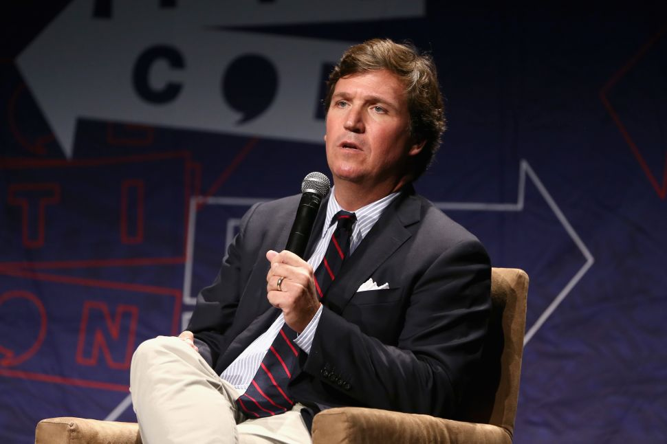 Tucker Carlson speaks onstage during Politicon 2018 at the Los Angeles Convention Center.