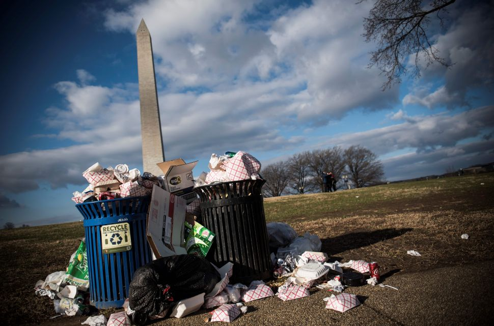 Litter spills out of a public dustbin next to the Washington Monument on the National Mall in Washington, D.C. on December 24, 2018.