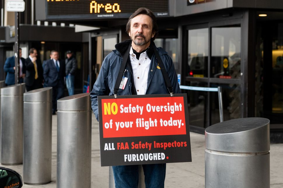 NEWARK, NJ, UNITED STATES - 2019/01/08: Protester seen outside a press conference in Terminal B at Newark Liberty International Airport with a placard telling people that FAA Safety Inspectors have been furloughed in Newark, New Jersey.
