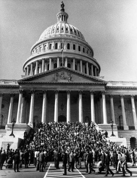 Anti-war demonstrators fill the steps of the United States Capitol Building on the day of the National Moratorium, on October 15, 1969.