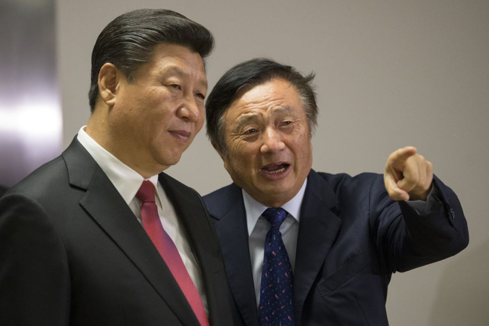 Ren Zhengfei shows Chinese President Xi Jinping around Huawei's London office during his state visit on October 21, 2015.
