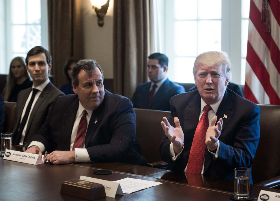 President Donald Trump speaks as Former Governor Chris Christie (C) and senior adviser Jared Kushner (L) look on during a meeting about opioid and drug abuse in the Cabinet Room at the White House in Washington, DC, on March 29, 2017.