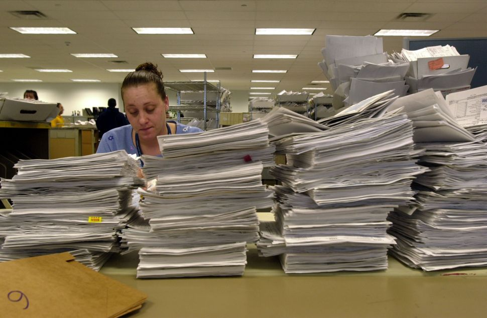 A typical IRS employee processes 50 tax return filings a day.