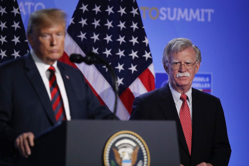President Donald Trump, flanked by National Security Advisor John Bolton.
