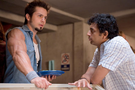 Freddy Rodríguez and M. Night Shyamalan in Lady in the Water.