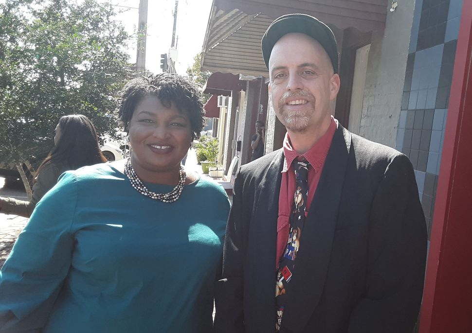 Stacey Abrams and John Tures.