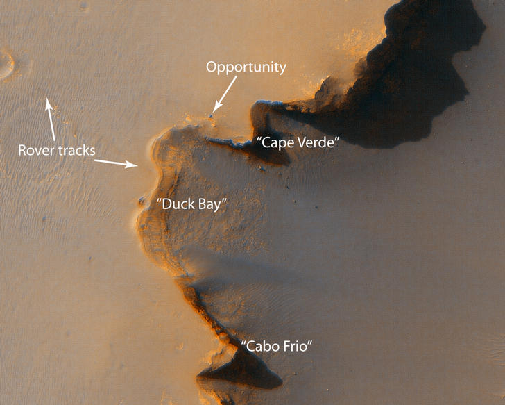 "This image from the High Resolution Imaging Science Experiment on NASA's Mars Reconnaissance Orbiter shows the Mars Exploration Rover Opportunity near the rim of ""Victoria crater"" near the equator of Mars."
