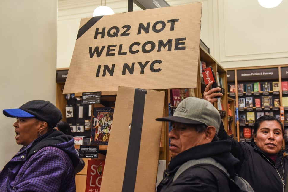 People opposed to Amazon's plan to locate a headquarters in New York City hold a protest inside an Amazon book store on November 26, 2018 in New York City.