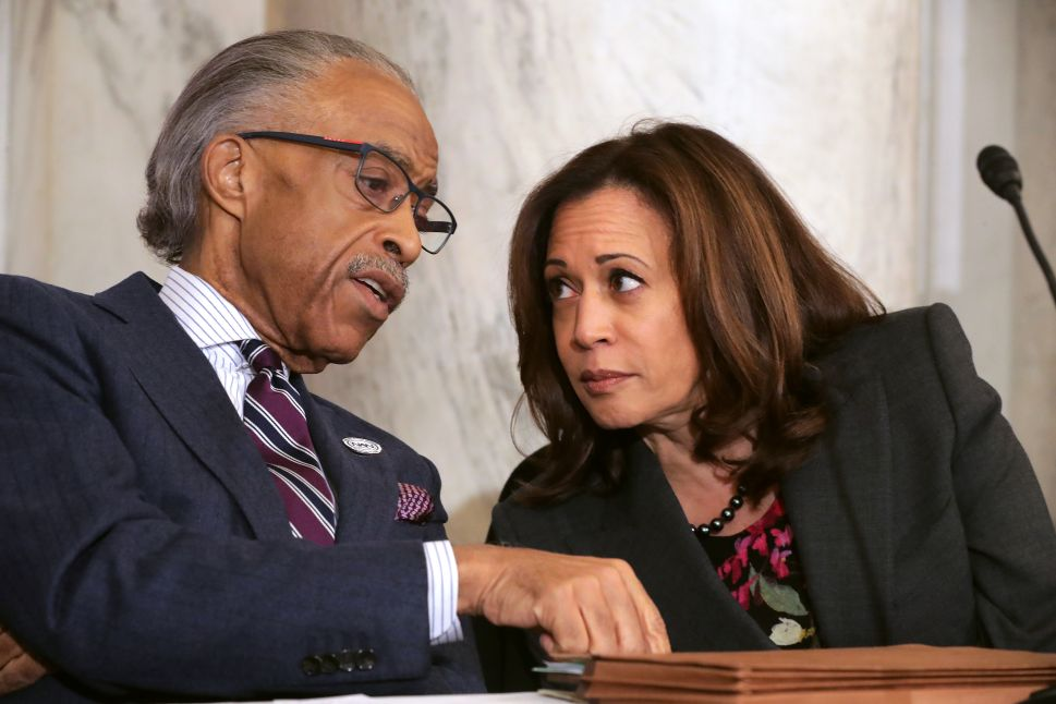 Rev. Al Sharpton (L) talks with Sen. Kamala Harris (D-Calif.) during a post-midterm election meeting.