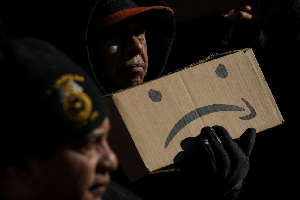 Protestors rally against Amazon's plans to build an HQ2 in Long Island City at New York City Hall, January 30, 2019.