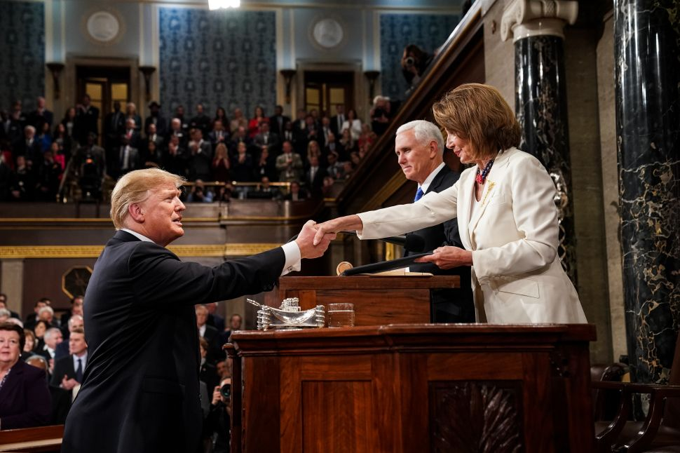 U.S. President Donald Trump shakes hands with Speaker of the House Nancy Pelosi (D-Calif.) while joined by Vice President Mike Pence before delivering the State of the Union address.