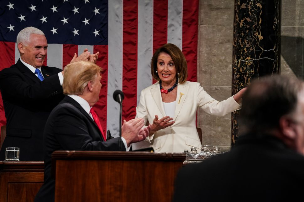 Speaker Nancy Pelosi gestures as President Donald Trump and Vice President Mike Pence applaud during the State of the Union address.