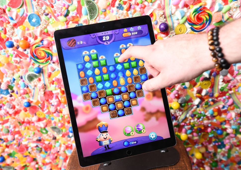 "Guest play the new Valentine's Day update in Candy Crush Friends Saga during the ""Sweet n Solo"" Singles Dining Experience at Dirt Candy on February 6, 2019 in New York City."