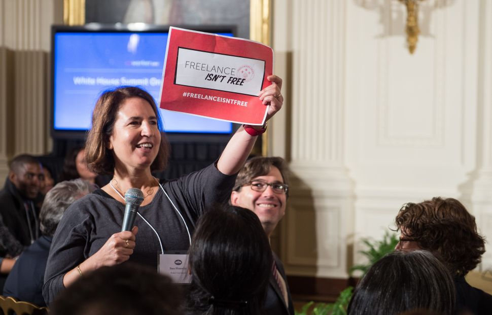 Sara Horowitz, founder of the Freelancers Union, shows a sign during a town hall meeting at the Summit on Worker Voice at the White House in Washington, D.C., on October 7, 2015.