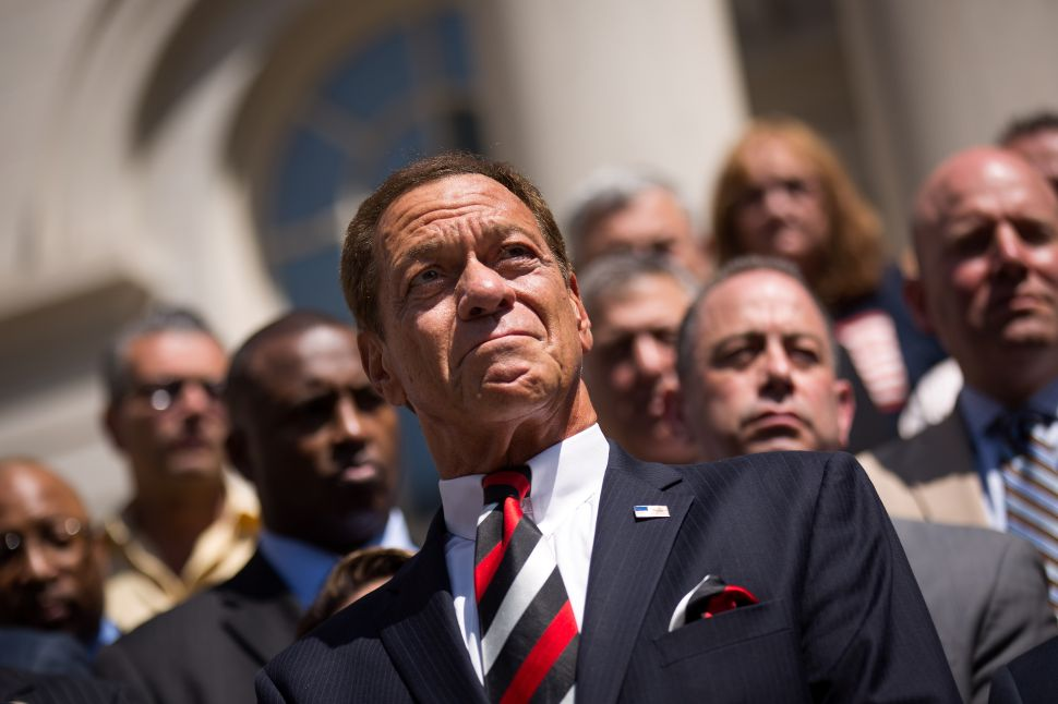 Joe Piscopo, actor and comedian, looks on outside of City Hall during a press conference and rally in support of the Christopher Columbus statue in Manhattan, August 24, 2017 in New York City.