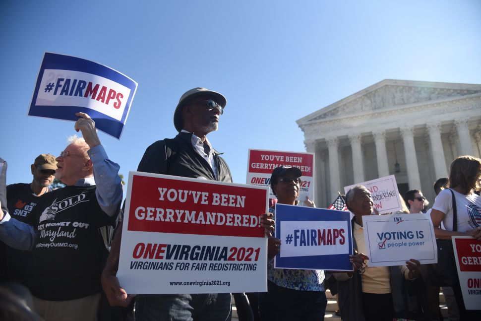 Demonstrators gather outside of the U.S. Supreme Court during oral arguments in Gill v. Whitford to call for an end to partisan gerrymandering on October 3, 2017 in Washington, D.C.