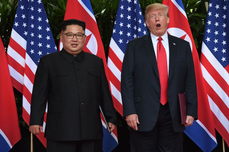 North Korea's leader Kim Jong-un poses with President Donald Trump.