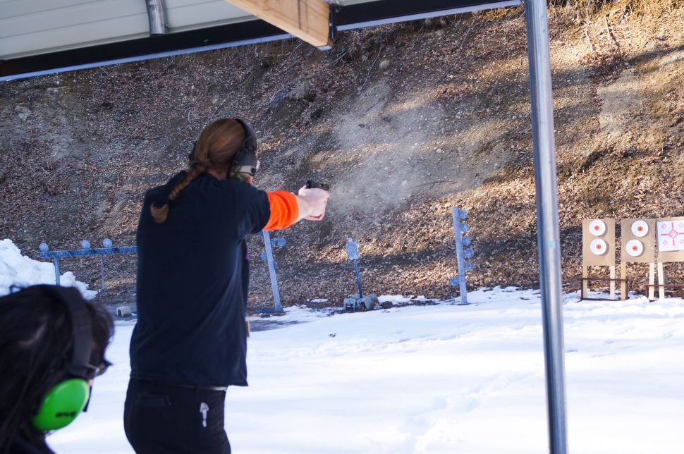 Grossman fires at a target during a monthly gathering of the Boston chapter of the Pink Pistols.