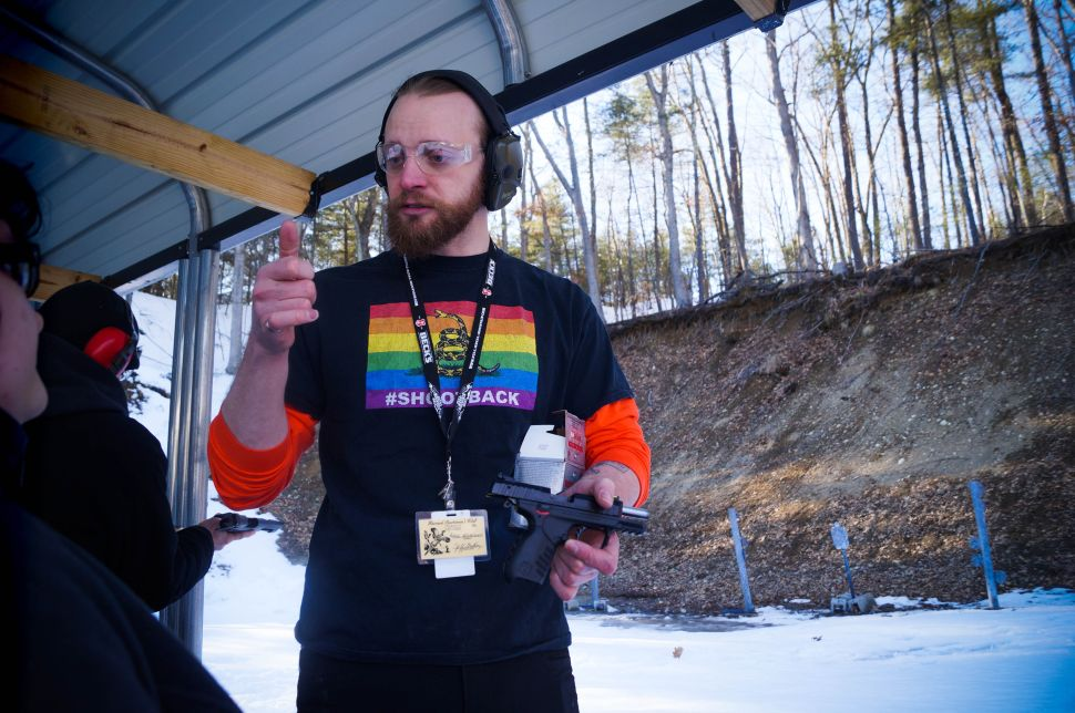 Grossman gives instructions to the, first-timers at the range on how to load bullets into the clip and the proper shooting stance.