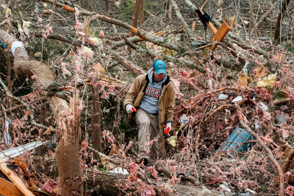 Joey Roush walks through debris on March 4, 2019 at his mother's home after it was destroyed by a tornado in Beauregard, Alabama.