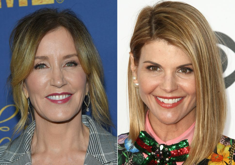 Actresses Felicity Huffman (L) and Lori Loughlin are among 50 people indicted in a nationwide university admissions scam, court records unsealed in Boston on March 12, 2019 showed.