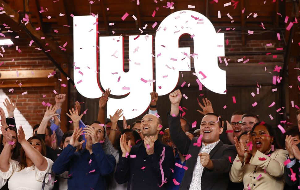 Lyft executives and employees ring the Nasdaq opening bell celebrating the company's IPO on March 29.