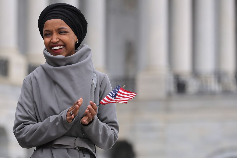 Rep. Ilhan Omar (D-Minn.) rallies with fellow Democrats before voting on H.R. 1.