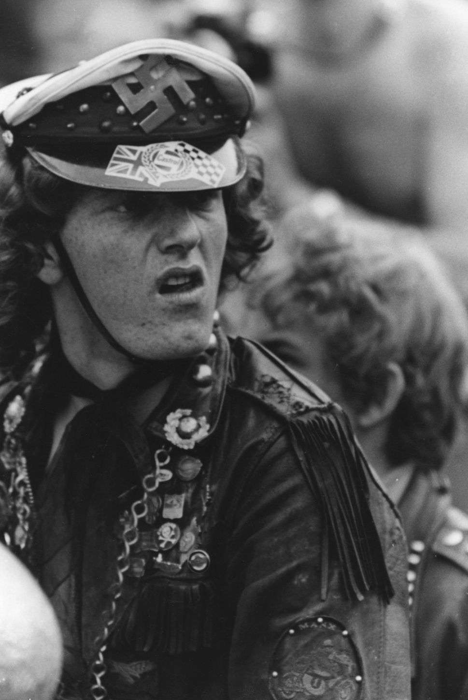 A member of the Hells Angels at a Rolling Stones Concert flaunts a swastika on his cap.
