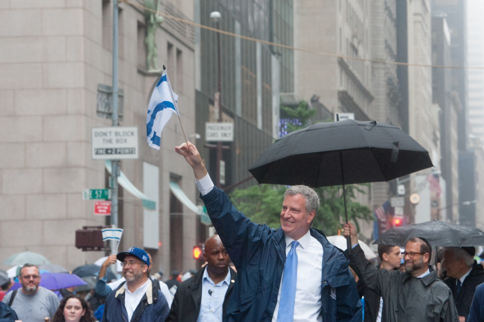 Mayor of New York City, Bill de Blasio marches in the Celebrate Israel Parade.