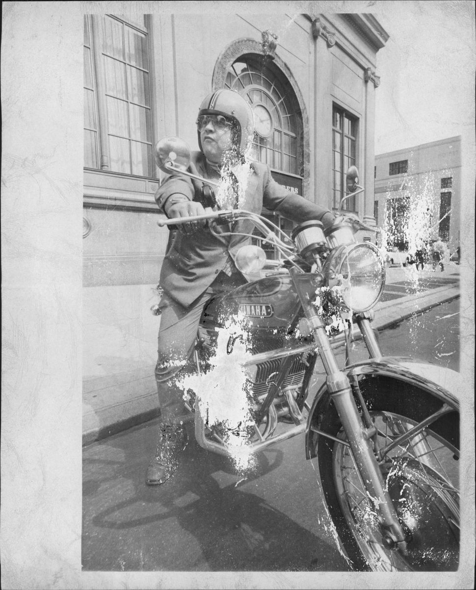 Hells Angels lawyer Stanley Siegel rides to his NYC office on—what else?—an orange motorcycle on July 11, 1972.