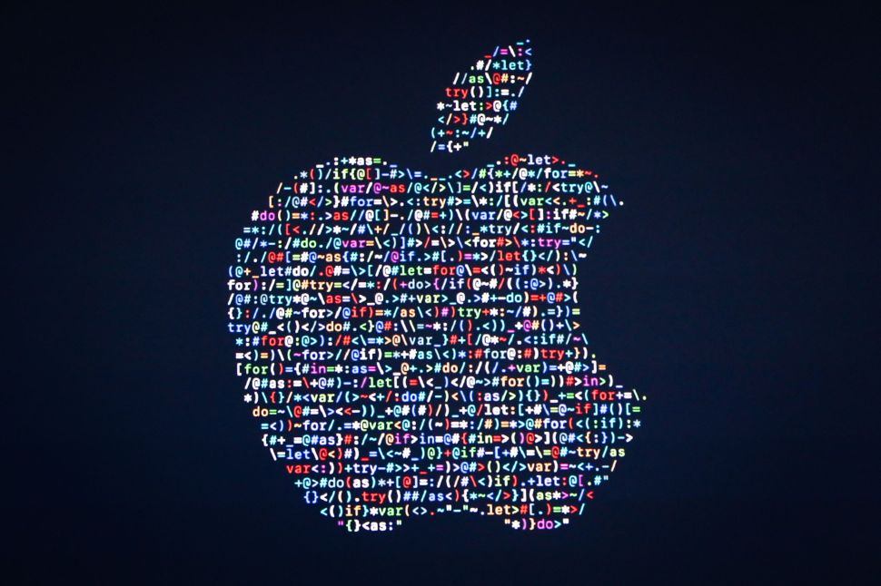The Apple logo is displayed on a screen at Apple's annual Worldwide Developers Conference on June 13, 2016.