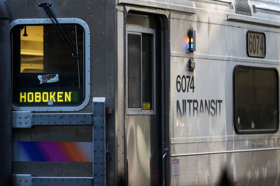 A New Jersey Transit train arrives at Hoboken Terminal during morning rush hour.