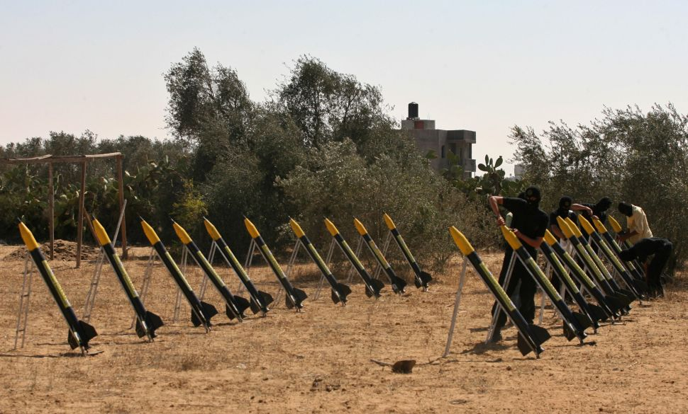 Palestinian militants from the Islamic Jihad's armed wing set-up home-made rockets during training at an undisclosed location in the Gaza Strip on August 13, 2008.
