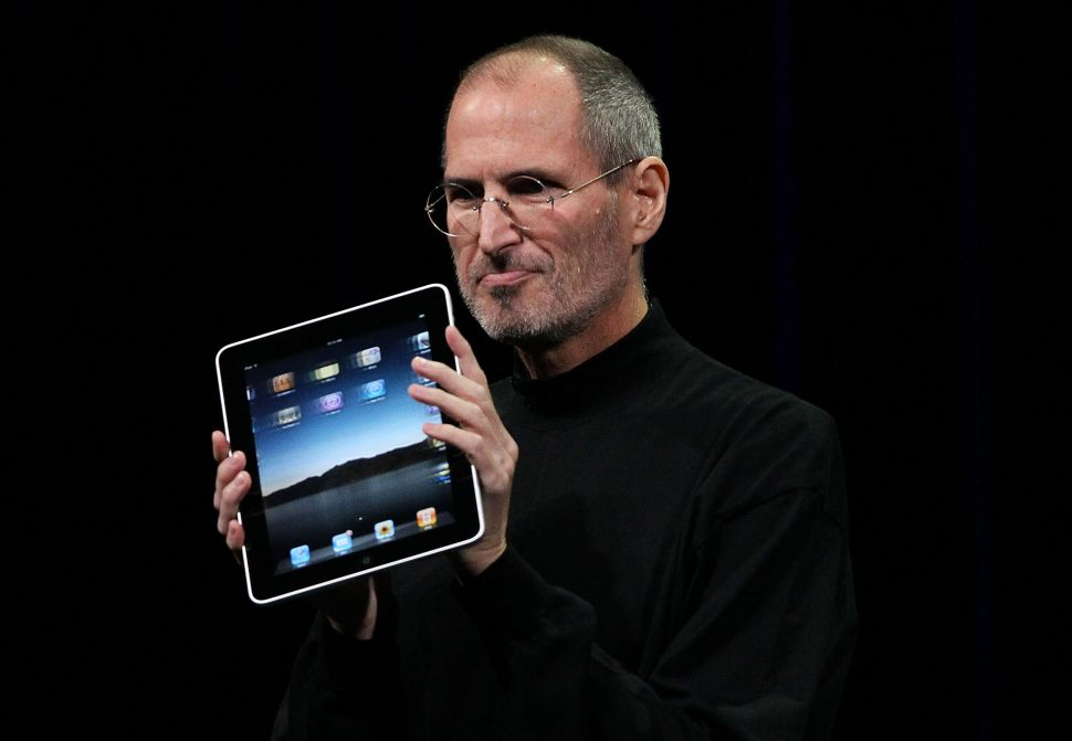 Steve Jobs holds up the first Apple iPad as he speaks during an Apple Special Event on January 27, 2010 in San Francisco, California.