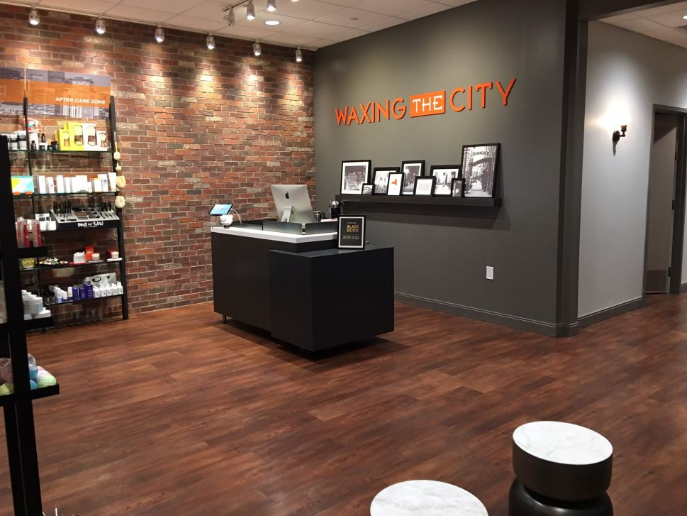 Inside the lobby of a Waxing the City location.