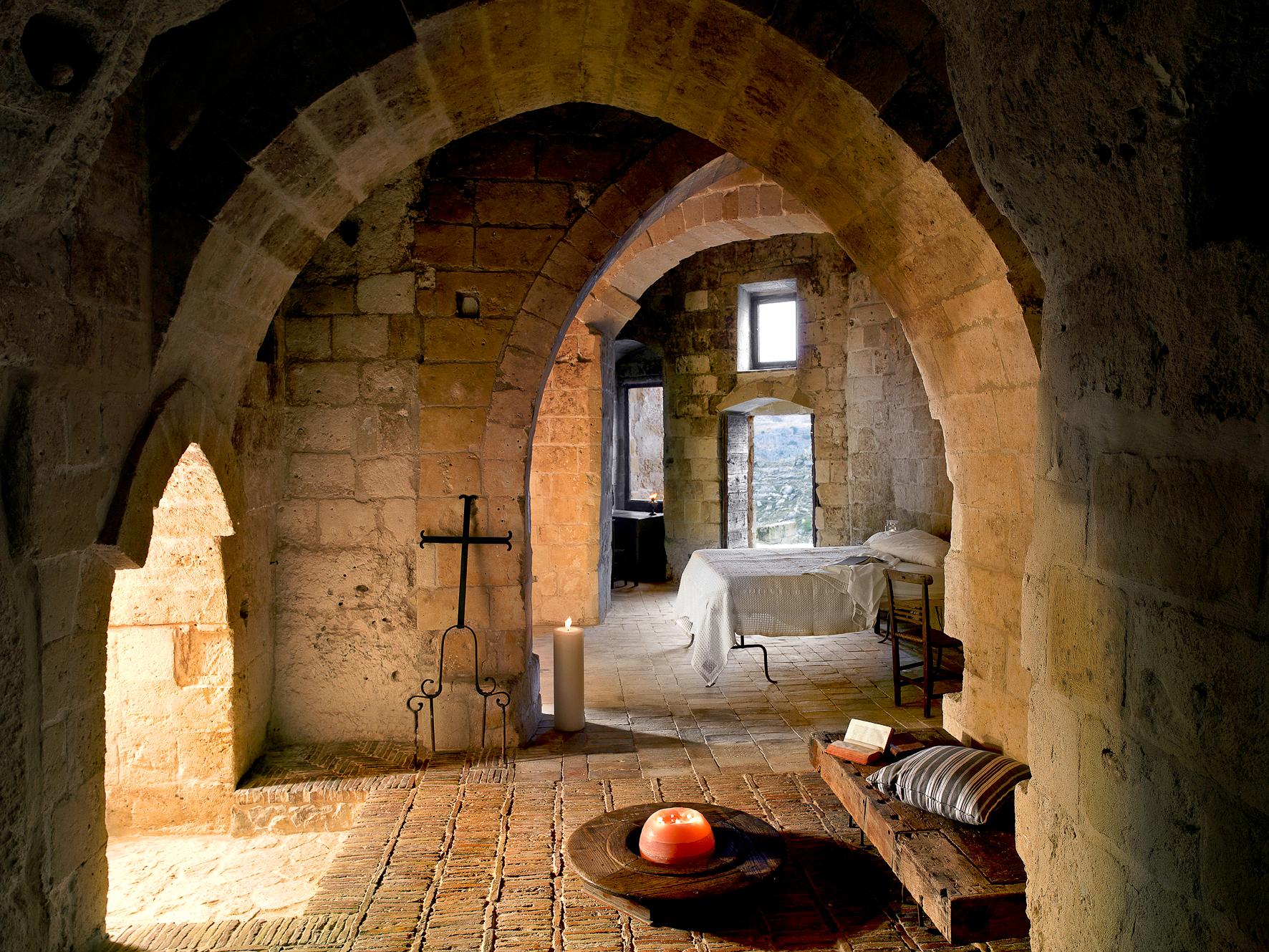 A luxe cave room at Sextantio Le Grotte della Civita