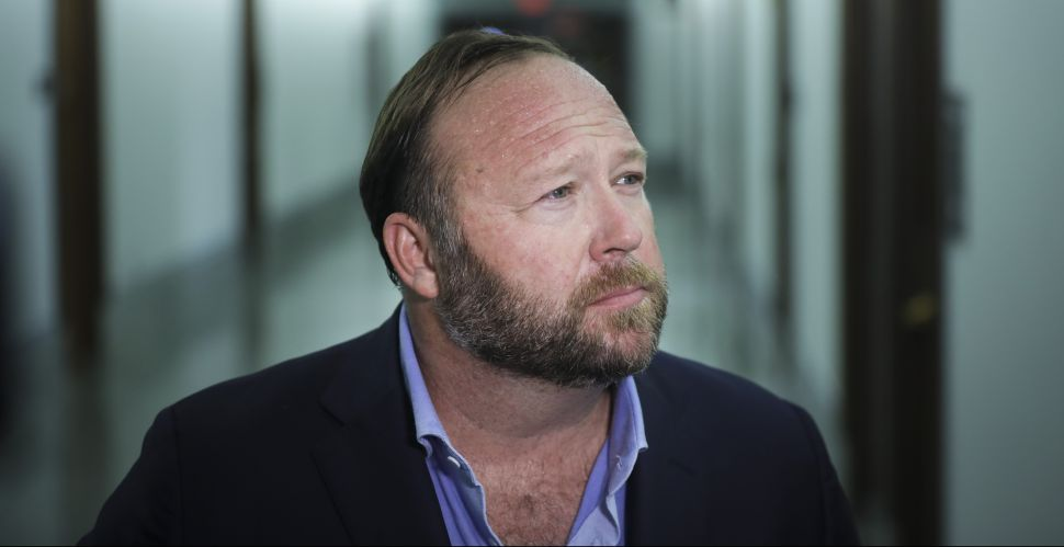 Alex Jones of InfoWars talks to reporters outside a Senate Intelligence Committee hearing concerning foreign influence operations' use of social media platforms, on Capitol Hill, September 5, 2018.