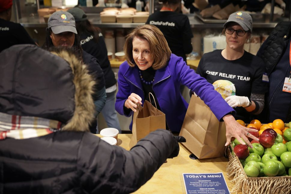 Speaker of the House Nancy Pelosi helps distribute food to furloughed federal workers.