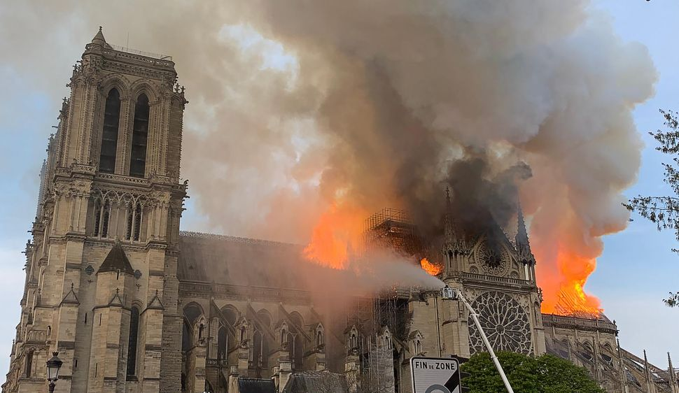 Flames and smoke are seen billowing from the roof at Notre Dame Cathedral in Paris on April 15, 2019.