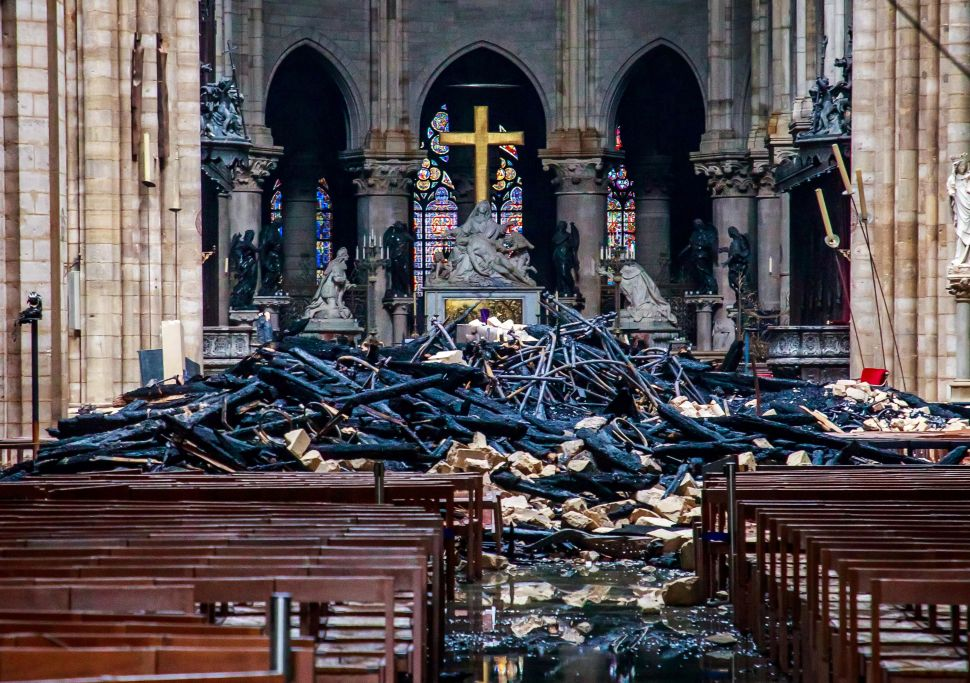 The debris inside the Notre Dame Cathedral a day after a fire devastated the building in the French capital.