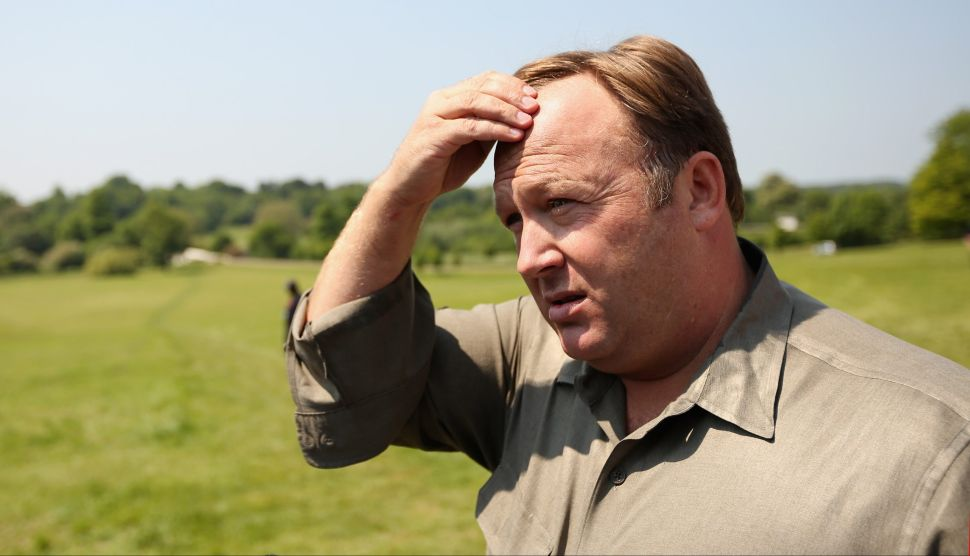 Alex Jones addresses media and protesters in the protester encampment outside The Grove Hotel, which hosted the annual Bilderberg Conference, on June 6, 2013 in Watford, England.