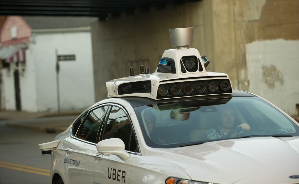 An Uber driverless Ford Fusion takes a test drive in Pittsburgh.