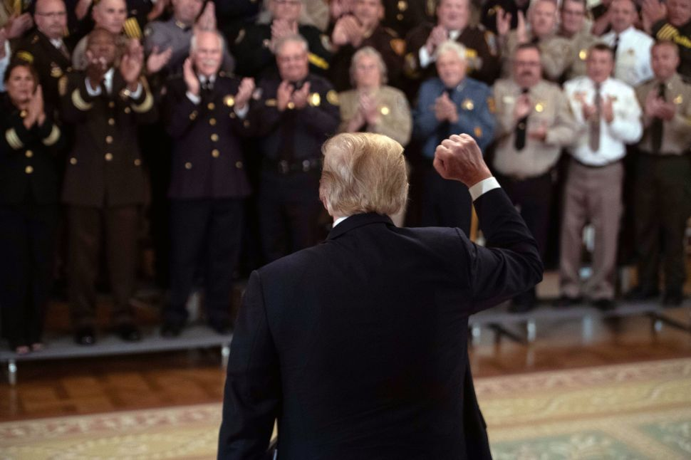 President Donald Trump is applauded by sheriffs from across the U.S.