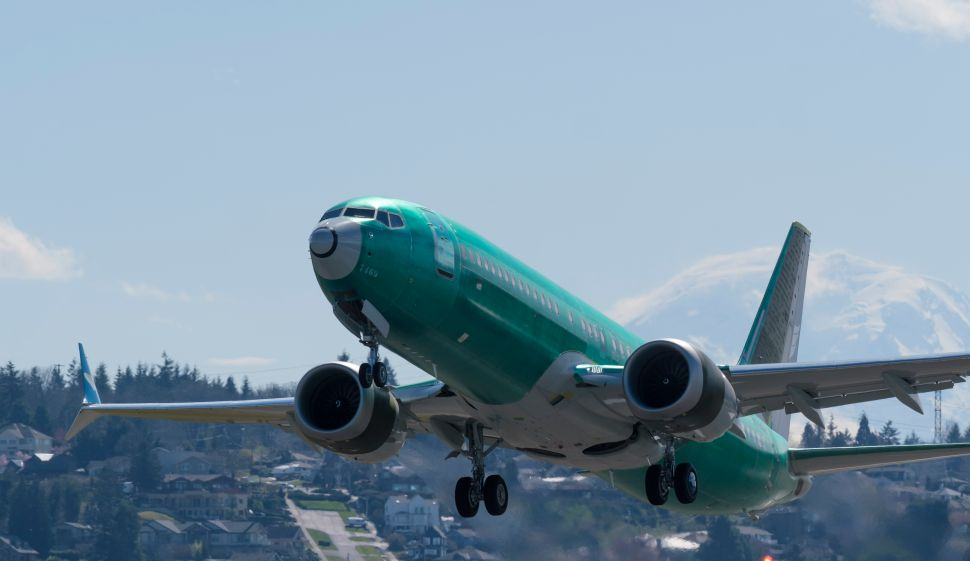 A Boeing 737 MAX 8 airliner takes off from  Renton Municipal Airport near the company's factory, on March 22, 2019 in Renton, Washington.