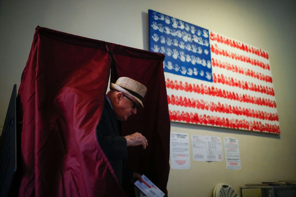 A man casts his ballot at a polling station during New Jersey's primary elections on June 7, 2016 in Hoboken, New Jersey.