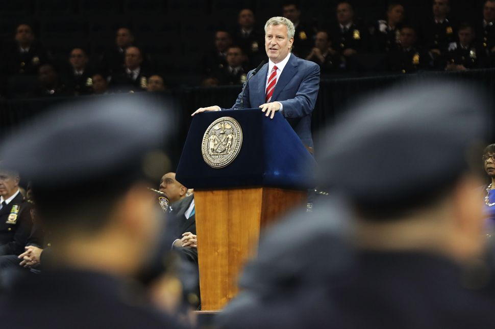 New York City Mayor Bill de Blasio speaks to new members of New York City's Police Department's graduating class during a swearing in ceremony at Madison Square Garden on July 1, 2016.